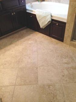 Updated tile floor in master bath
